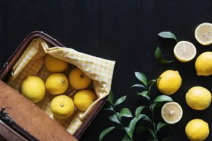 Fresh yellow lemons on black