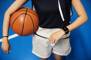 Teenage girl holding a basketball