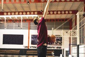 Teenage boy on a basketball goal