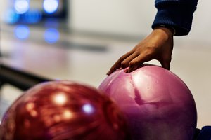 Girl picking up a bowling