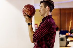 Boy about to roll a bowling