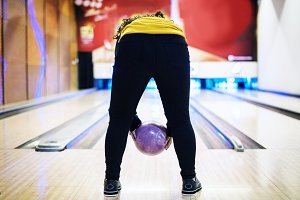 Girl bowling with two hands