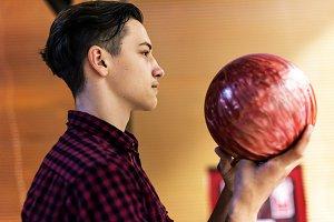 Boy carrying the bowling ball