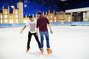 Friends having fun ice skating