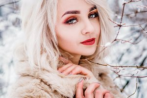 A charming girl in a fur coat