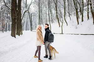 Loving couple walking with dog