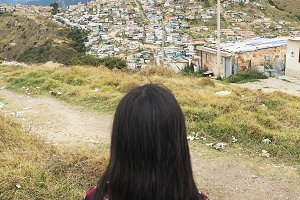 Back view of girl in shanty town.