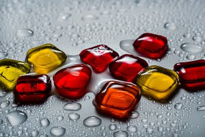 colored glass stones with water drop