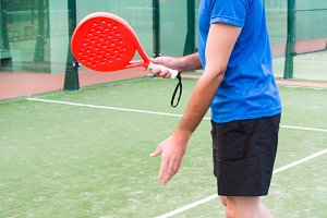 Man playing paddle tennis