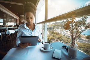 Black businesswoman with tablet pc