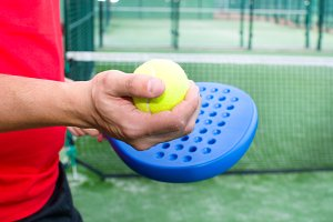 man playying paddle tennis