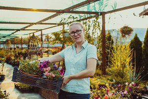 Happy gardener with plant