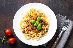 Spaghetti bolognese  on dark stone table.
