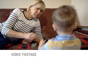 Grandmother and granson playing