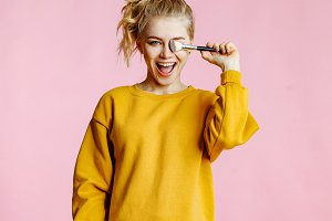 cheerful blonde does a make-up