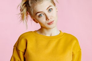 blonde in a yellow sweatshirt