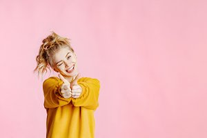 positive blonde in yellow sweatshirt