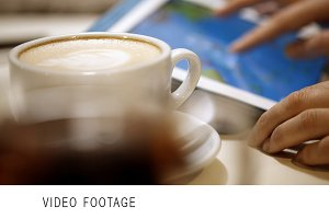 Woman using touch pad during coffee