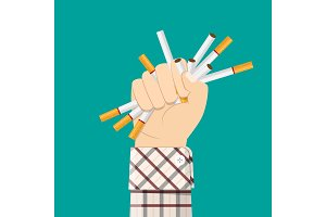 Cigarettes in fist hand. giving up smoking.