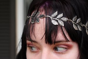 Young woman close up silver headband