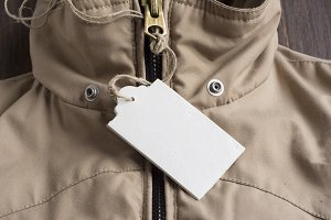 Price Tag on beige winter jacket wit