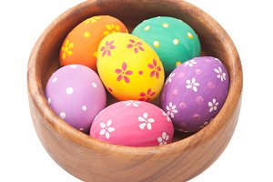 Easter eggs in wooden bowl.