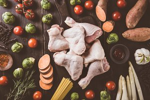 Raw chicken pieces and fresh veggies