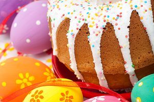 Easter cake, several colorful eggs.