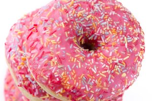 Pink frosted donut isolated
