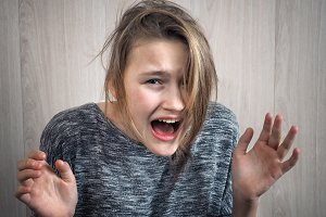 Girl is experiencing strong emotions-fear, horror, hysterics
