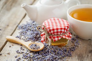Honey, teapot and lavender tea cup.