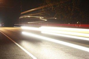 Headlight Blur on Wooded Road