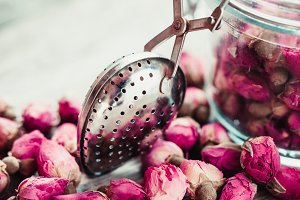 Rose buds and tea strainer.