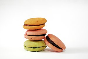 Four macaroons on white cutout.