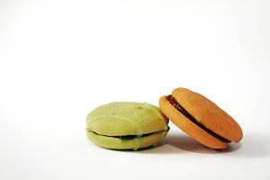 Two macaroons on white cutout.