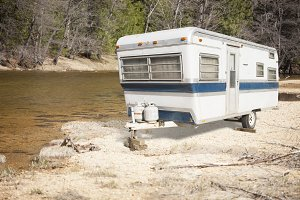 Classic Old Camper Trailer Near Lake