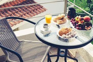 Healthy breakfast on the balcony is served for one person.