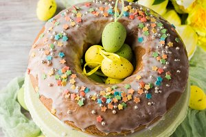 Easter cake with frosting, sprinkles and eggs