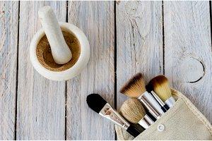 Set of makeup brushes. Mortar and cosmetics.