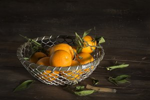 Group of oranges in a metal basket