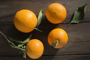 Set of oranges on wooden background