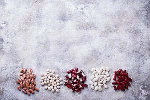 Assortment of various beans on light  background