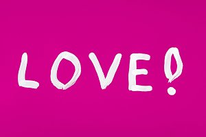 Love word painted on pink