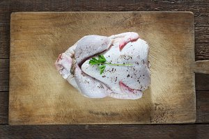 Chicken on a dark wooden background,