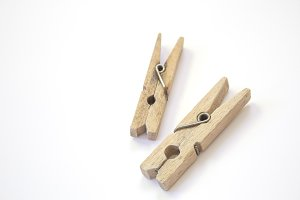 Wooden clothespin on a white backgro