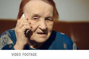 Elderly woman talking on cell phone