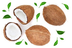whole coconut with half decorated with leaves isolated on white background. Flat lay. Top view