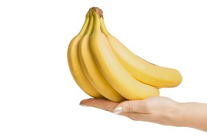 Hand with bananas , isolated