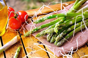 Asparagus with tomatoes in the field