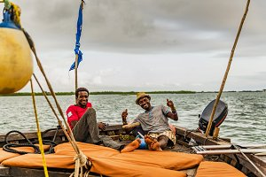 African fishermen relax on a boat